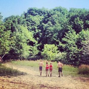 My team running into the woods after completing an obstacle!